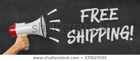 a man holding a megaphone   free shipping stock photo © zerbor
