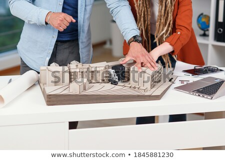 female colleagues architect using tablet pc in office stock photo © diego_cervo