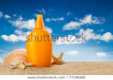 suntan oil in summer Stock photo © adrenalina