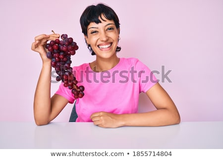 Cheerful attractive yougn woman with bunch of fresh grape Stock photo © deandrobot