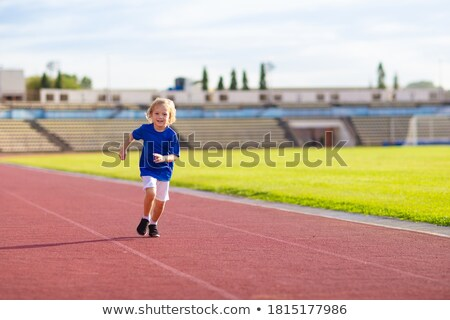 A young boy jogging Stock photo © bluering