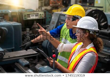 Woman working on milling machine. Stock photo © RAStudio