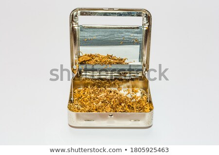 Tobacco with filter and rolling machine Stock photo © berczy04