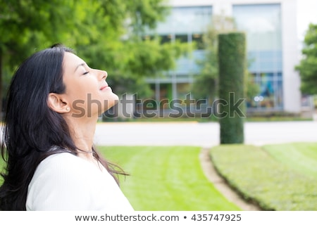 Girl Smells Fresh Air Stock photo © FOTOYOU