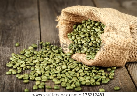 roasted coffee beans with green leaves stock photo © digifoodstock