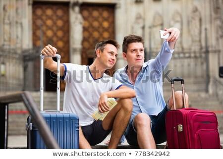 Homo paar twee mannen smartphone Stockfoto © diego_cervo