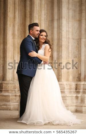 Gyönyörű esküvő pár kapualj pózol ház Stock fotó © tekso