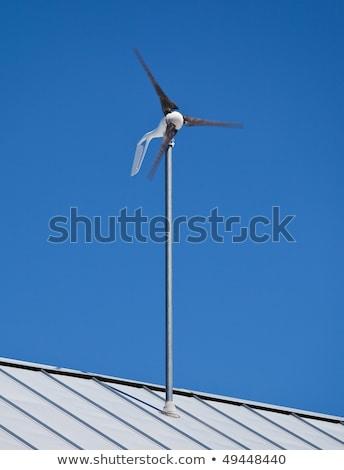 Faible éolienne moulin à vent attaché toit énergie Photo stock © BrandonSeidel