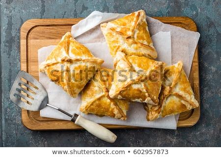 Crunchy puff pastry pies, homemade baking, top view Stock photo © yelenayemchuk