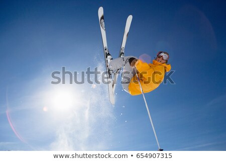Skier jumping shot from bellow stock photo © IS2