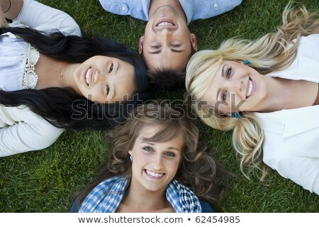 four teen girls portrait laying on grass stock photo © is2