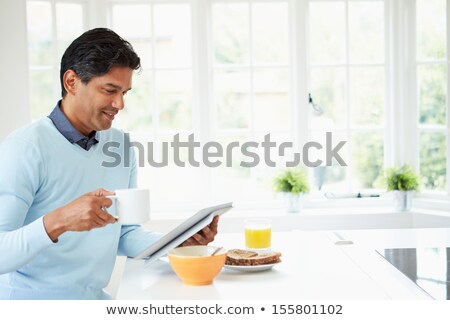Man reading and eating a meal Stock photo © IS2