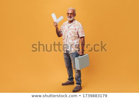 Older man holding ticket Stock photo © IS2
