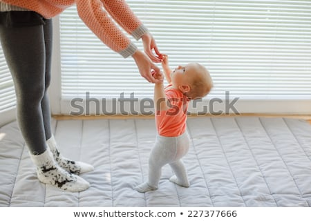 A mother helping her baby to walk. Stock photo © IS2