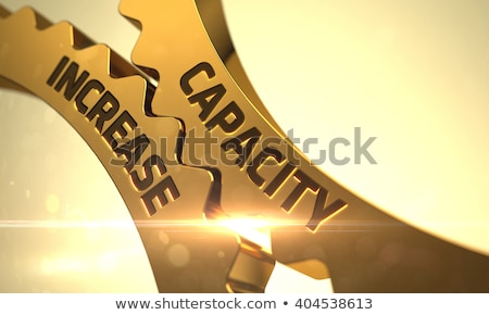 capacity increase concept golden metallic cog gears stock photo © tashatuvango