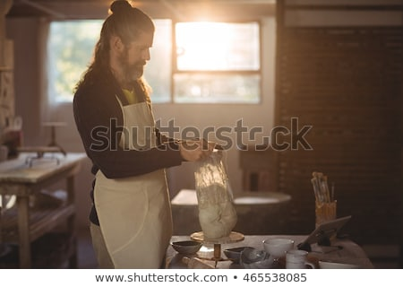 Male potter removing plastic cover from molding clay Stock photo © wavebreak_media