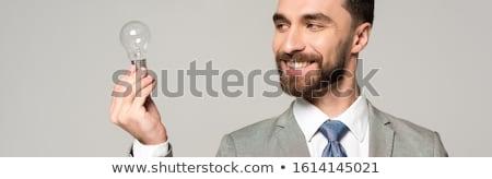 European businessman holding idea light bulb Stock photo © studioworkstock