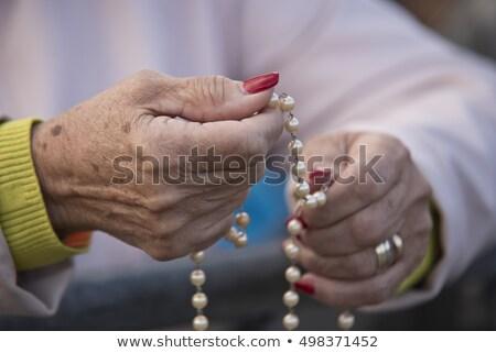 Nő tart rózsafüzér kéz női hit Stock fotó © IS2