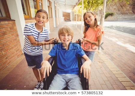 drie · glimlachend · vrienden · vergadering · samen - stockfoto © wavebreak_media