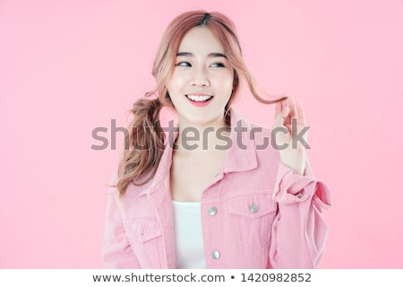 portrait of smiling beautiful woman promoting a healthy lifestyl Stock photo © feedough