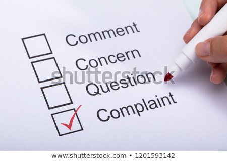 Woman Ticking Complaint Box On Form Stock photo © AndreyPopov