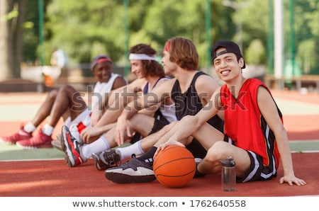 group of young multiethnic men basketball players stock photo © deandrobot