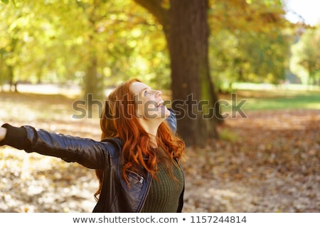 Stock photo: Happy woman in forest enjoying nature. Girl standing outdoors in