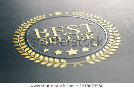 Golden Best Seller Award Over Black Paper Background Stock photo © olivier_le_moal