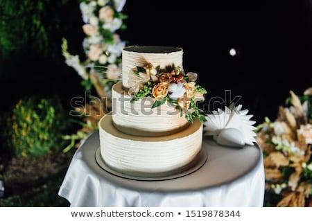 Esküvői torta három padlók kívül este lámpák Stock fotó © ruslanshramko