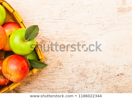 Pink lady royal gala red and granny smith green apples in vintage box on wooden background.  Stock photo © DenisMArt