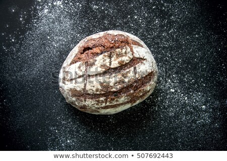 Freshly baked healthy white bread on a black background with copy space. Top view Stock photo © artjazz