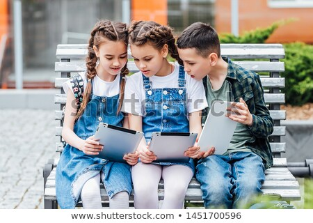 two cute school childs working on their homework stock photo © lopolo