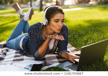 женщину студент Ложь улице парка используя ноутбук Сток-фото © deandrobot