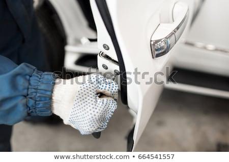Closeup white Car door handle. Car equipment.selective focus Stock photo © ruslanshramko