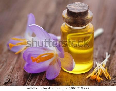 yellow crocus or saffron with essential oil stock photo © bdspn