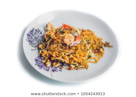 Phad thai, the famous Thai style fried noodle.Signature dish of Thailand. Isolated on white Stock photo © galitskaya