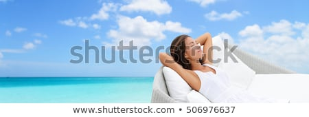 luxury woman lying on blue couch stock photo © dariazu