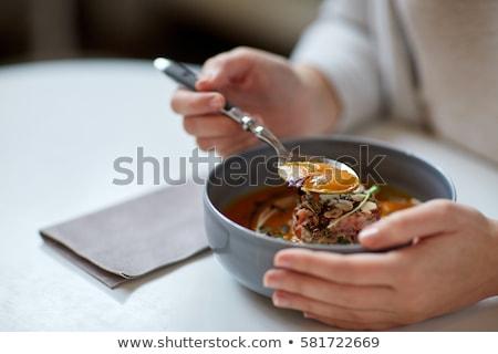 woman eating pumpkin cream soup at restaurant Stock photo © dolgachov