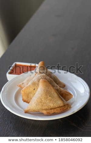 Traditional Indian Food snack Samosa served in a plate on a white wooden table Stock photo © dash