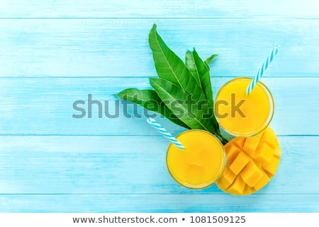 Foto stock: Tropical cocktail with mango on light background