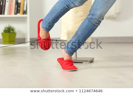 Woman Legs Stumbling With An Electrical Cord Stock photo © AndreyPopov