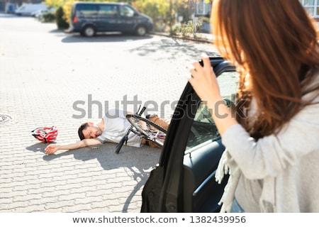 Mulher jovem olhando inconsciente masculino ciclista rua Foto stock © AndreyPopov