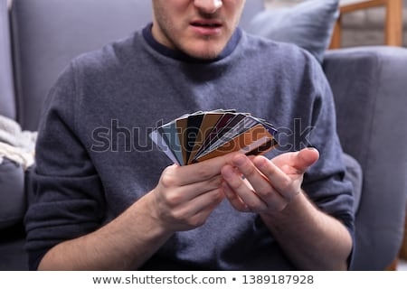 человека глядя многие кредитные карты домой Сток-фото © AndreyPopov