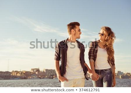 young couple enjoying picnic on beach together stock photo © monkey_business