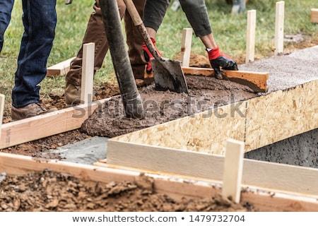 Bouwvakker nat cement hout mannen industriële Stockfoto © feverpitch