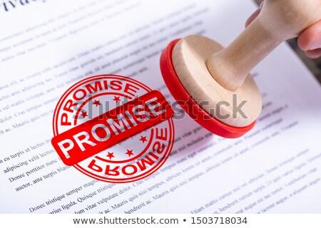 Affaires promettre tampon document main affaires Photo stock © AndreyPopov