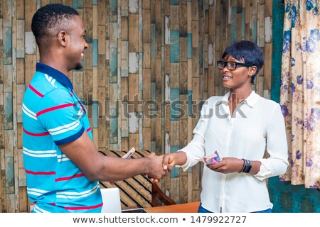 Male And Female Hands On Settlement Agreement Stock photo © AndreyPopov