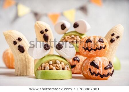 Halloween treat marshmallow in chocolate Stock photo © furmanphoto