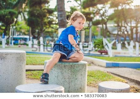 Cute ragazzo up pietra blocchi Foto d'archivio © galitskaya