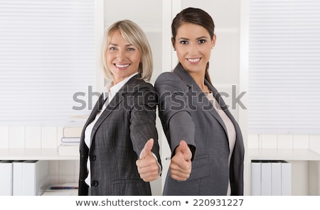 business team making thumbs up gesture at office stock photo © dolgachov